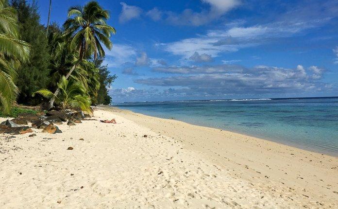 Girl Laying on Island Beach Rarotonga