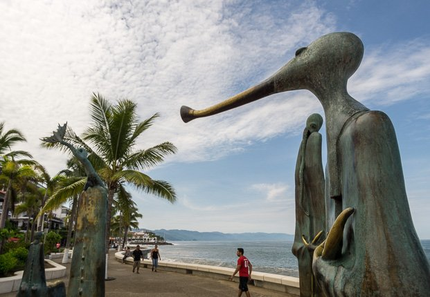 uerto Vallarta's Malecon area is a must see when visiting this destination city. Located along the Pacific Ocean front the Malecon stretches for 12 blocks, almost a mile long, and is full of spectacular artwork, shops, stands, bars and restaurants. On any day of the week you will find something happening along Puerto Vallarta's Malecon.